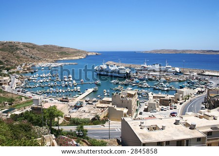 A panorama view of Mgarr port with ferry on Gozo island, Malta. - stock photo