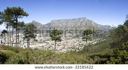 A panorama view of Table Mountain from the park at the top of Signal Hill. This image looks out over the city of Cape Town in South Africa. - stock photo