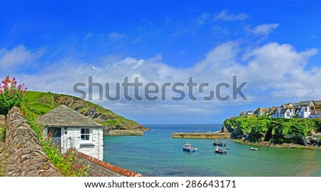 A panorama view of the Cornish fishing village and harbor of Port Issac on a beautiful summers day, with blue sky and clouds, Cornwall, United Kingdom