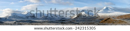 A panoramic image of a snow covered mountain range called the Black-mount, Glencoe, Scotland. - stock photo