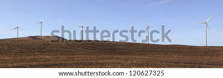 A panoramic image of windmills on a hill near Oakesdale, Washington. - stock photo