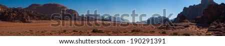 A Panoramic Scenery of Wadi Rum, Valley of The Moon in Jordan. Desert Mountain Range - stock photo