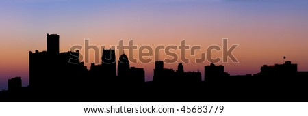 A panoramic silhouette of the Detroit Skyline as seen from Belle Isle. - stock photo