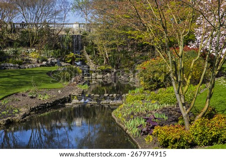 A panoramic view of a little waterfall in Hyde Park in London. - stock photo