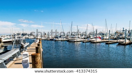 A panoramic view of a marina near Canton Waterfront Park in Baltimore Harbor in Maryland. - stock photo