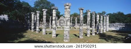 A panoramic view of columns surround grassy courtyard for ballgames at Chichen Itza, Mayan Ruins in the Yucatan Peninsula, Mexico - stock photo