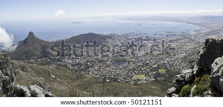 A panoramic view of Lions Head, Signal Hill and the city bowl of Cape Town, South Africa, as seen from the top of Table Mountain - stock photo