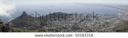 A panoramic view of Lions Head, Signal Hill and the city bowl of Cape Town, South Africa, as seen from the top of Table Mountain. - stock photo