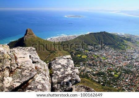 A panoramic view of Lions Head, Signal Hill, Robben Island, and Cape Town, South Africa, as seen from the top of Table Mountain. - stock photo