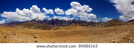 A panoramic view of mountain range with blue sky and barren land,near leh, ladakh, Jammu and  Kashmir, India