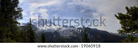 A panoramic view of Mt. Rainier on a summer day - stock photo