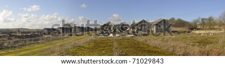 A panoramic view of some derelict huts