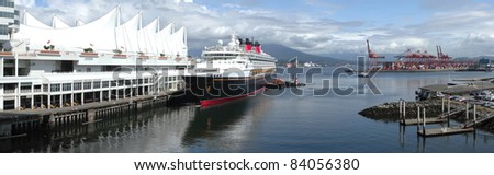 A panoramic view of the Burrard Inlet waterway at Canada place a cruise ship and surroundings. - stock photo