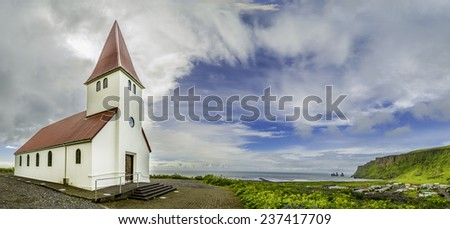 A panoramic view of the church and town of Vik, Iceland - stock photo