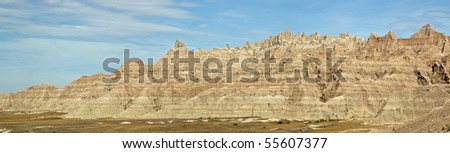 A panoramic view of the colorful layers of the eroding sandstone in Badlands National Park, South Dakota. - stock photo