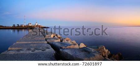 A Panoramic View Of The Eastern Point Lighthouse And Dog Bar Breakwater As The Sun Initiates Another New England Day, Gloucester, Massachusetts, USA - stock photo