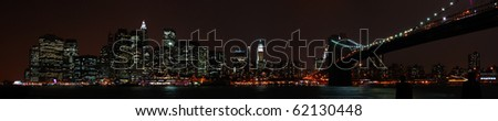 A panoramic view of the financial district skyline of New York City, photographed from the Brooklyn side of the East River. - stock photo