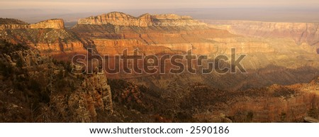 A panoramic view of the Grand Canyon from Point Imperial viewpoint on North Rim lit by setting sun.