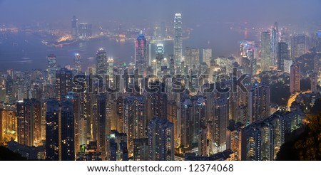 A panoramic view of the Hong Kong skyline from Victoria Peak at night - stock photo