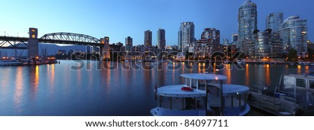A panoramic view of the Old bridge False creek bay and the Vancouver BC skyline at dusk from Granville island Canada. - stock photo