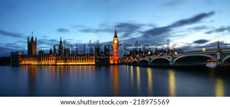 A panoramic view of the Palace of Westminster and the Big Ben with the river Thames in front. London. - stock photo