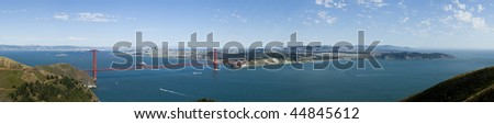 A panoramic view of the San Fransisco bay area from the pacific side of The Golden Gate, with the city skyline in the background against a blue summer sky. - stock photo