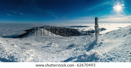 A panoramic view of the snowy landscape from The Giant Mountain in Czech Republic. - stock photo