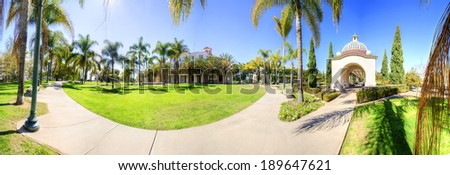 A panoramic view of the Veterans Museum and Memorial Center and some of the arched colorful mosaic architecture and palm trees in Balboa Park in San Diego, California in the United States of America. - stock photo