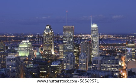 A panoramic view on Montreal downtown at dusk taken from Mont Royal. - stock photo