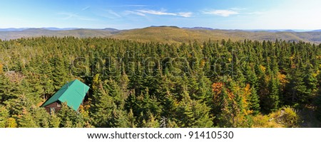 A panoramic view to the east from Balsam Lake Mountain fire tower in early autumn in the Catskills Mountains of New York - stock photo