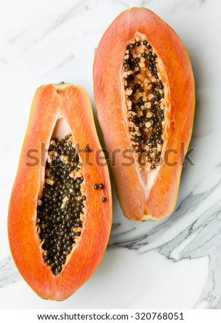 A papaya cut in half - stock photo