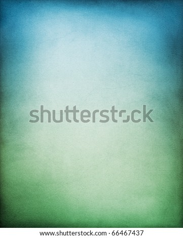A paper background with a blue to green gradation. - stock photo