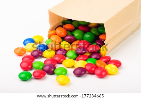 A paper bag with colorful chocolate candies - stock photo