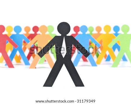 A paper businessman stands in front of a multicolored crew. - stock photo