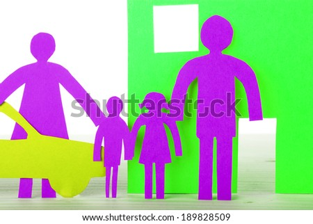 A Paper Family with House and Car in Neon Colors, Isolated - stock photo