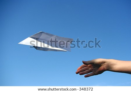 a paper plane that was just thrown in the air. Symbolizes concepts like success, independence or freedom - stock photo