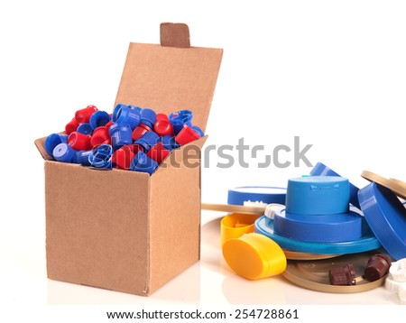 a paperboard box with a lot of caps for recycle on a white background - stock photo