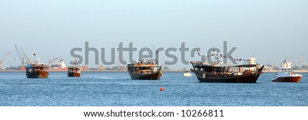 A parade of Arab dhows, decked out with Qatari flags, during Doha Cultural Week, March, 2008 - stock photo