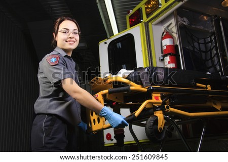 A paramedic person with his job background. - stock photo