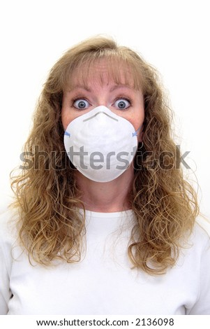 A Paranoid caucasian woman wearing a protective mask with a scared look on her face. She's afraid of infectious diseases. Isolated on white - stock photo