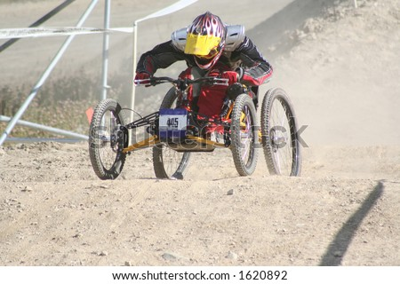 A paraplegic racer rips down the hill in Whistler, BC. - stock photo