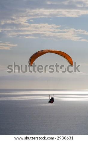 A parasailer soars over the Pacific in La Jolla, California - stock photo