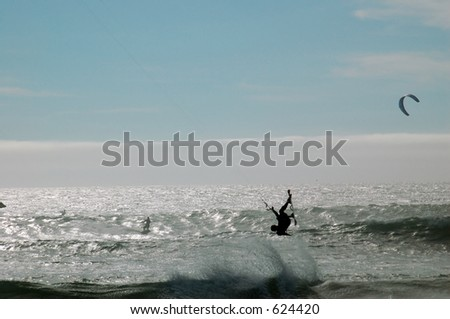 A parasurfer riding the waves