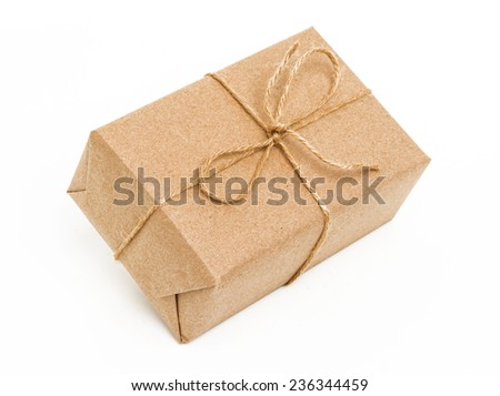 A parcel wrapped in brown paper and tied with rough twine - stock photo