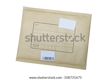 A parcel wrapped in brown paper and tied with rough twine and blank label, isolated on white background. Shallow depth of field - stock photo