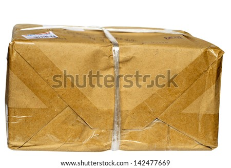 A parcel wrapped in brown paper and tied with rough twine and blank label, isolated on white background - stock photo