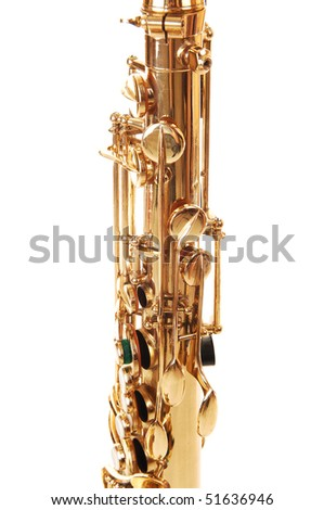 A part of a beautiful brass saxophone on the floor of a studio for white background.
