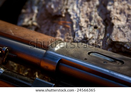 a part of a .30-30 hunting rifle. - stock photo