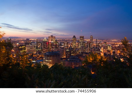 A Part of Downtown Montreal view from the mountain of Mont-Royal at dusk - stock photo