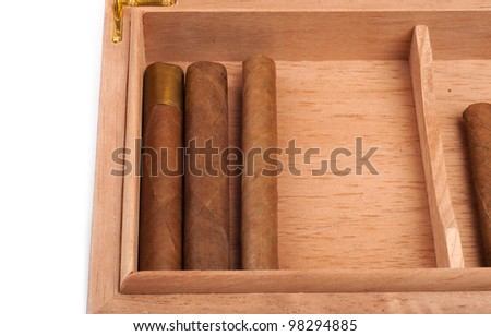A part of opened humidor with cigars isolated on white background - stock photo